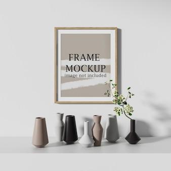 Рамка плаката макета висит на стене