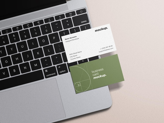 Mockup of professional stationery business card on laptop keyboard office work concept isolated