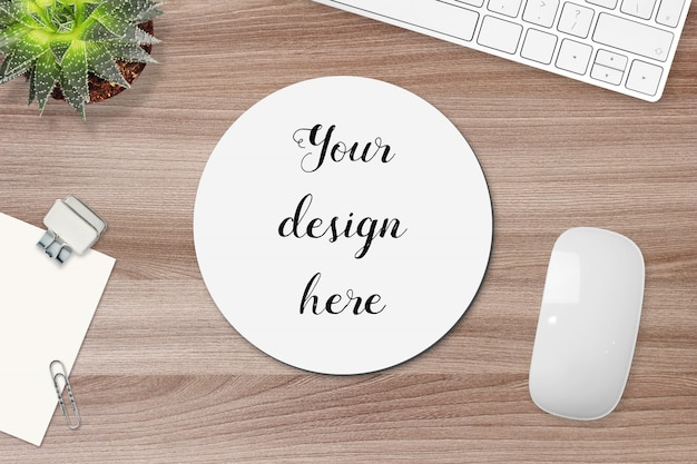 Mockup of round mouse pad on a work table