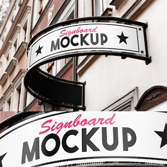 Mockup of rounded signboard on old building