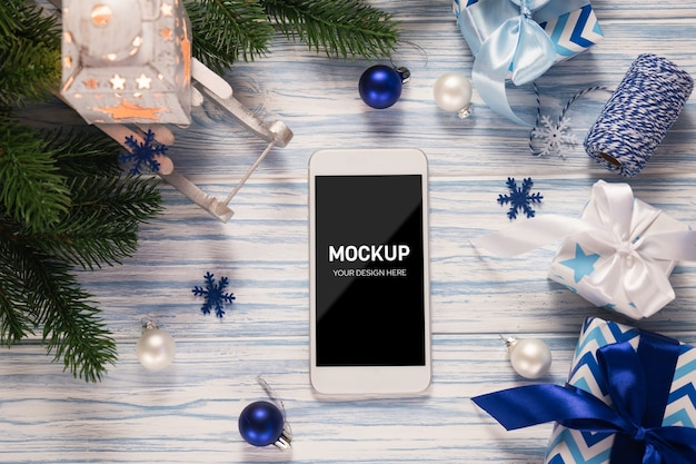 Mockup screen smartphone with plane model among christmas decorations