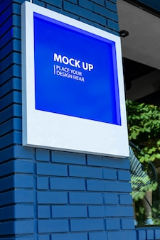 Mockup sign on a blue wall
