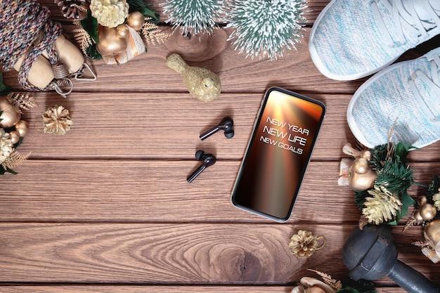 新年の解像度の健康的な概念のためのモックアップスマートフォン