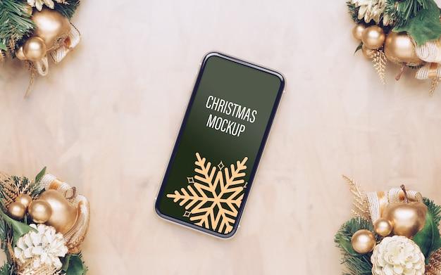 Мокап смартфона в рамке рождество новый год