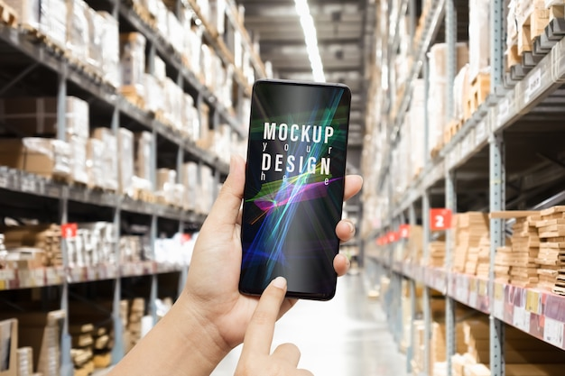 Mockup smartphone in warehouse for logistic wholesale storehouse