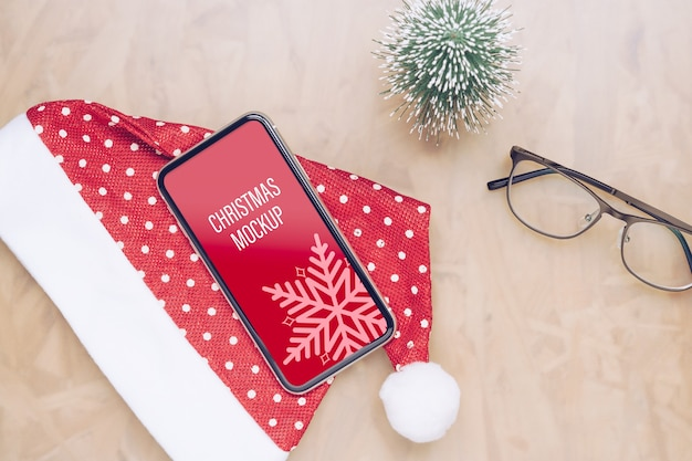 Mockup smartphone with santa claus hat christmas