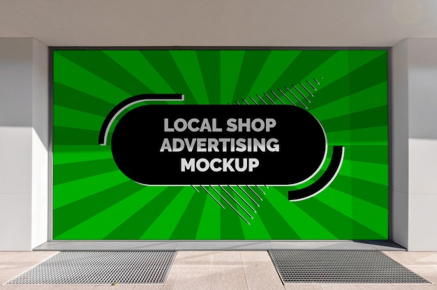 Mockup of the street city outdoor advertising horizontal billboard banner in black frame at the local shop window