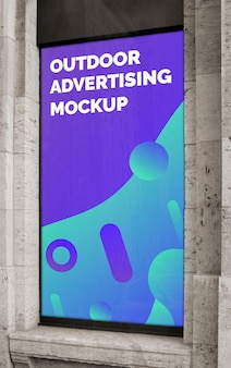 Mockup of the street city outdoor advertising vertical banner poster on the window