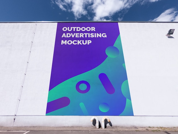Mockup of the street city outdoor advertising vertical billboard painting on the building wall