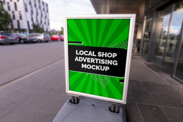 Mockup of the street city outdoor advertising vertical poster stand in silver frame at the local shop