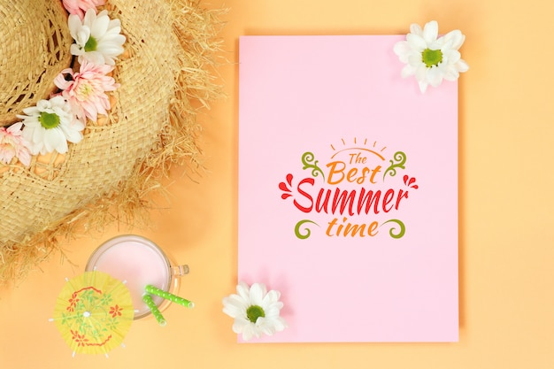 Mockup template with straw hat and summer cocktail
