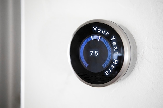 Mockup of thermostat on white wall