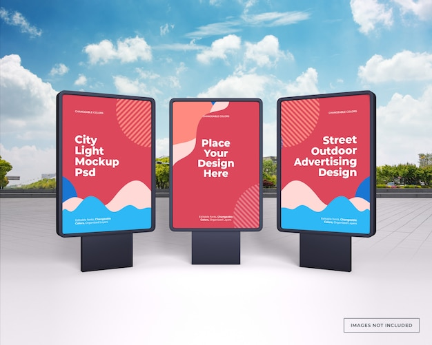Mockup of three black vertical outdoor advertising stands on city street