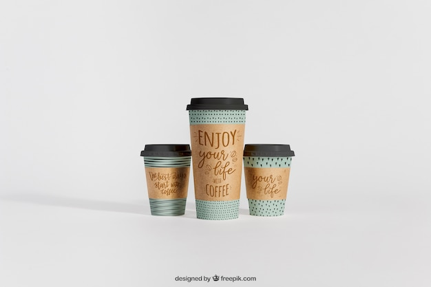 Mockup of three coffee cups of different sizes