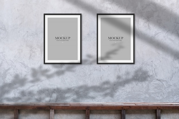 Mockup two blank photos frame on cement wall