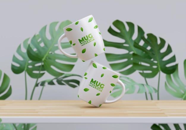 Мокап две кружки с дизайном листвы