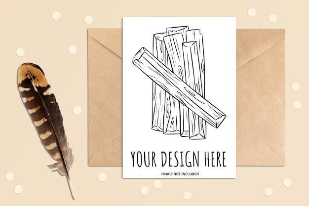 Mockup of vertical postcard on a table with envelope and feather elements