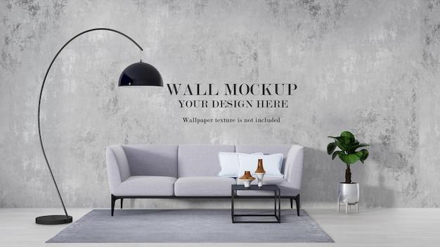 Макет стены за изогнутым торшером и диваном