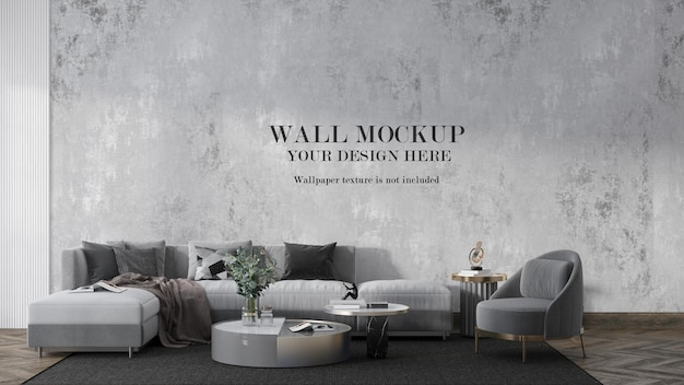 大きな灰色のソファの後ろのモックアップ壁
