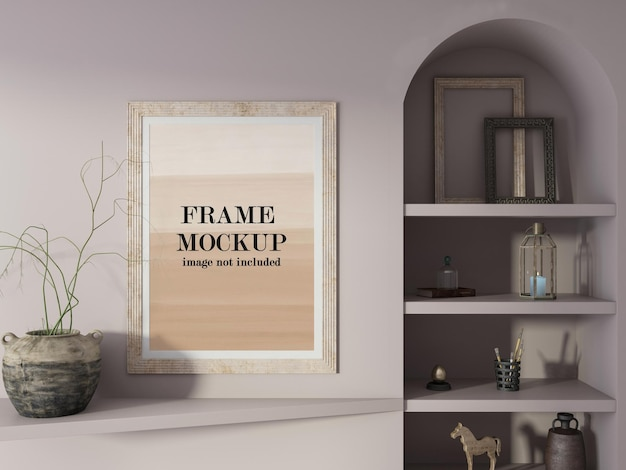 Mockup wall frame beside ceramic pot
