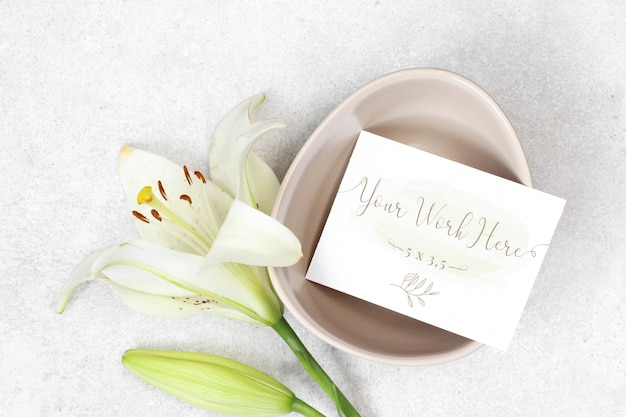 Mockup wedding card with flowers on grey background
