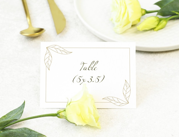 Mockup wedding card with gold cutlery