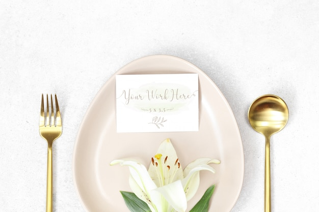 Mockup wedding card with lily in a plate