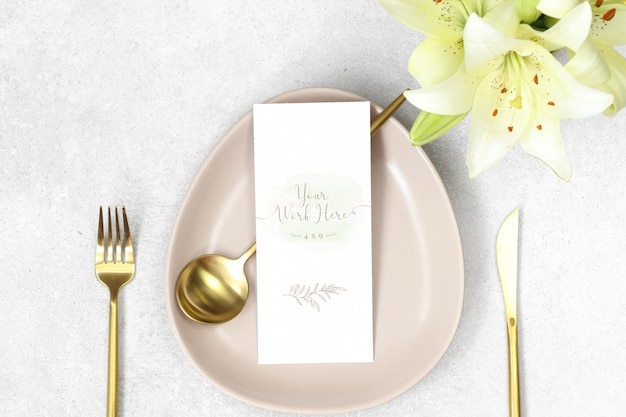 Mockup wedding menu with gold cutlery and lilies