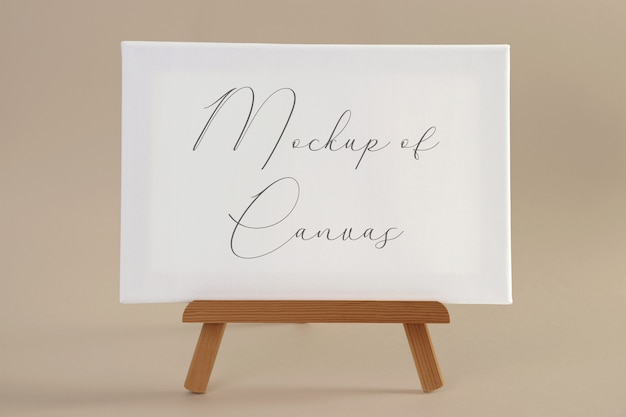 Mockup of a white canvas on a small wooden easel
