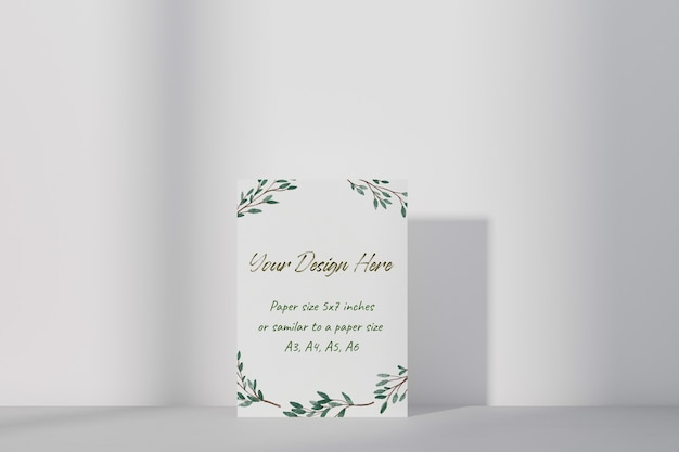 Mockup white greeting card standing on table