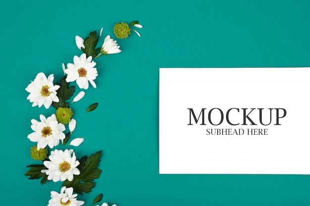 Mockup of white notebook and chrysanthemum flowers