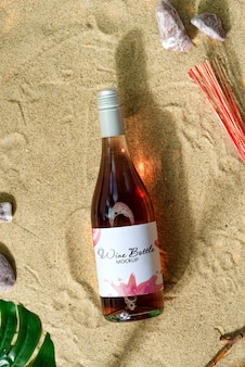 Mockup wine bottle on a beach.