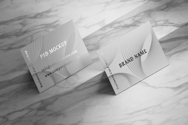 Mockup with top view of business cards on marble