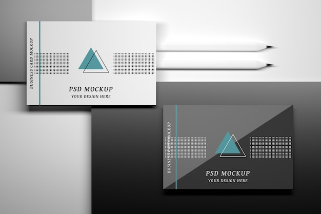 Mockup with top view of business cards and pencils