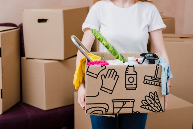 Mockup of woman with cardboard boxes