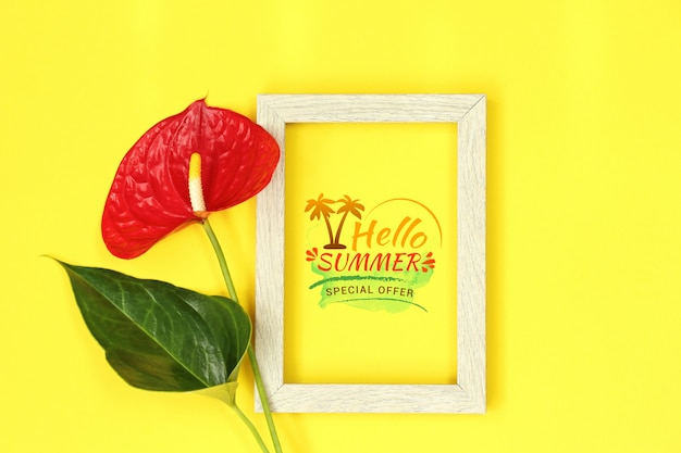 Mockup wooden frame with red flower