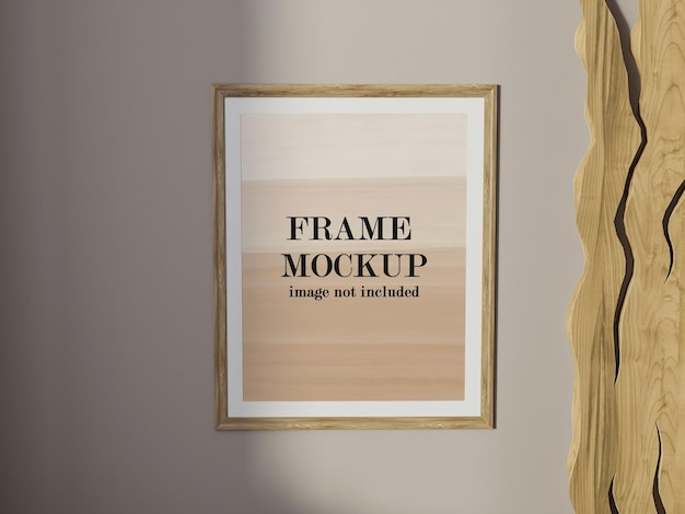 Mockup wooden poster frame on wall
