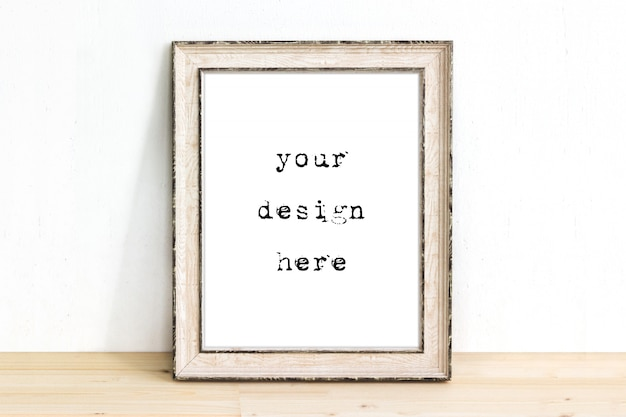 Mockup of a wooden rustic picture frame standing on table