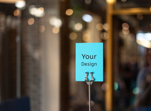 Mockup your design sign inside a restaurant, store, office