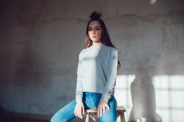 Model woman with blank sweatshirt mockup template