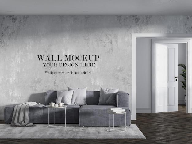 Современный угловой диван перед пустой стеной
