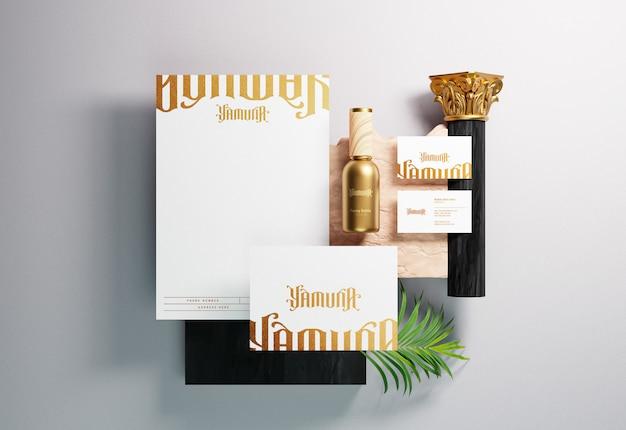 金箔プリント効果のある現代の企業ブランドアイデンティティと文房具のモックアップ