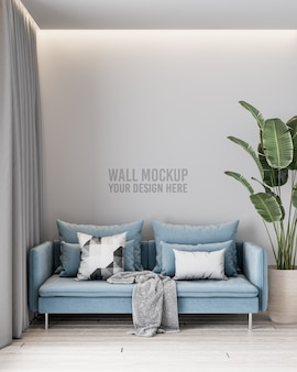 Modern living room wall mockup with blue sofa and pillows and plant