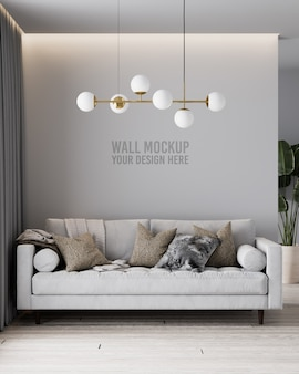 Modern living room wall mockup with grey sofa and pillows