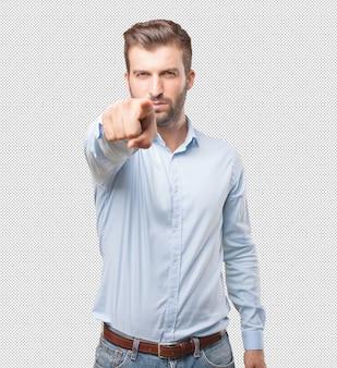 Modern man pointing towards you