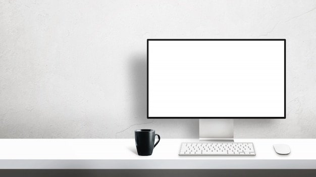 Modern profesional designer computer monitor mockup on office desk with copy space beside on wall