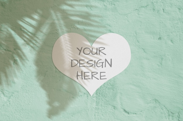Modern and stylish greeting heart card or invitation mock up with palm tropic shadow