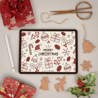 Modern tablet with merry christmas theme on