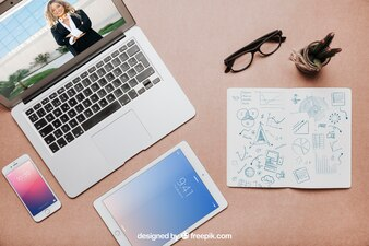 Modern workspace mockup with laptop and tablet