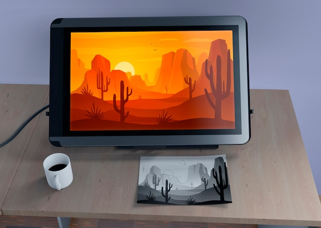 Monitor with nature landscape and sketch